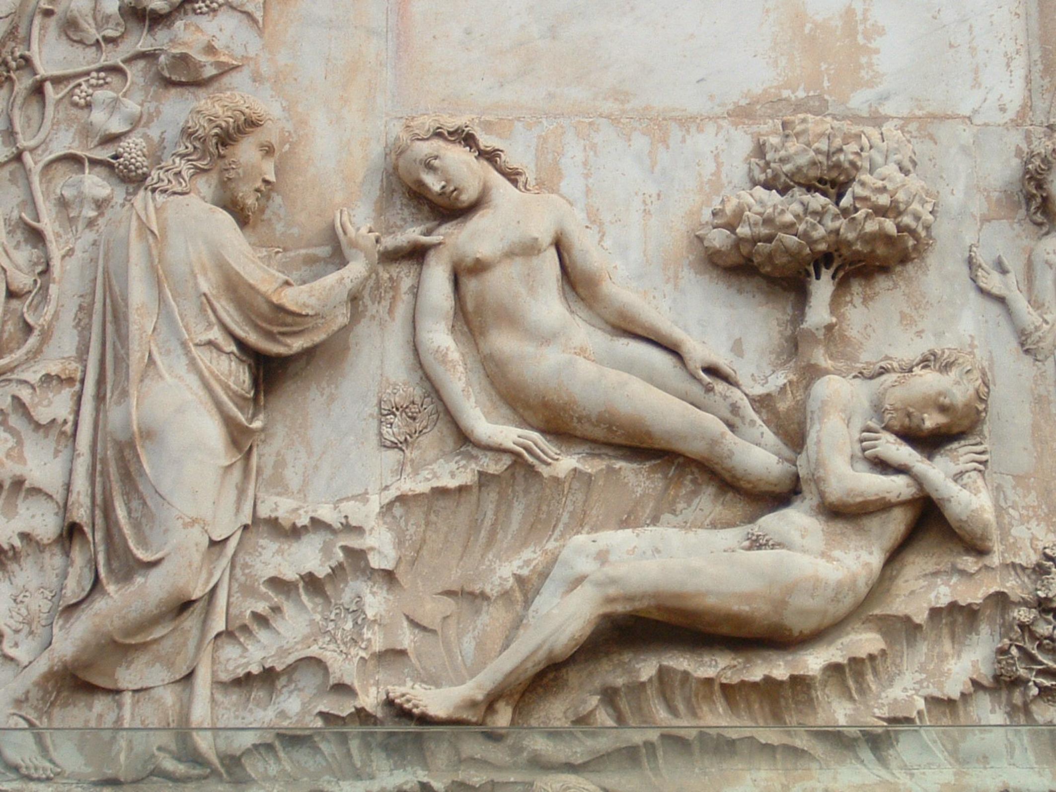 Eva viene generata dalla costola di Adamo (Lorenzo Maitani e bottega, dettaglio della facciata del Duomo di Orvieto).
